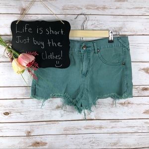Free People green high waist distressed jean short